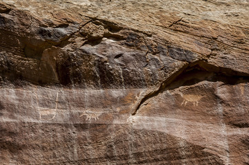 Rock art figures created by ancient Native Americans can be seen in several places in Capitol Reef National Park. The rock art is a must-see attraction along the main highway through the park.