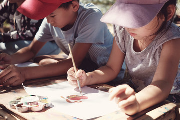 Kids painting art outdoor activity, montessori homeschooling education