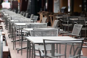 A Few Lined Table at A Open-Air Cafe.
