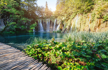 Majestic view on turquoise water and sunny beams. Location Plitvice Lakes National Park, Croatia, Europe.