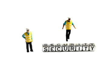 Security on beads with miniature scale model security guards isolated on a white background