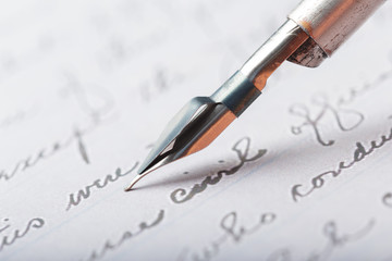 Fountain pen on an antique handwritten letter