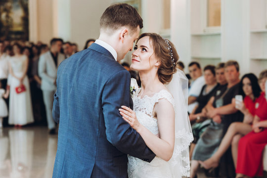 beautiful gorgeous bride and groom performing first dance. happy wedding couple dancing in restaurant at wedding reception. happy marriage moments. elopement concept
