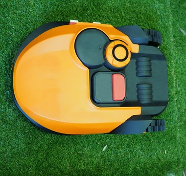 Robot lawn mower on grass, Close up and top view