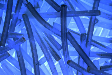 abstract blue background of curved short sticks