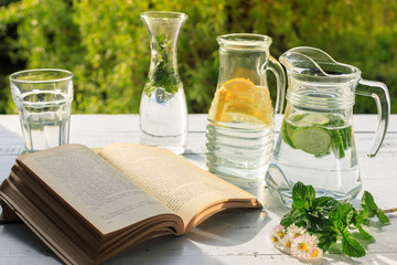 Relax time with book and fresh homemade lemonade.