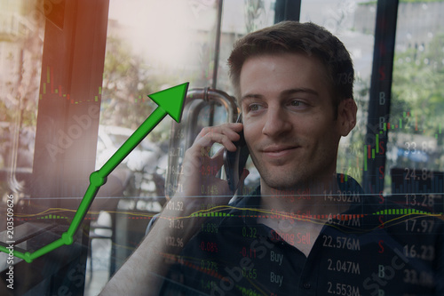 Happy investor on mobile device getting information that stock price