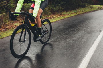 Cyclist training outdoors on a rainy day