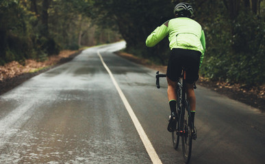 Cyclist practising on a rainy day Wall mural