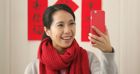 Chinese woman taking selfie in lunar new year holiday