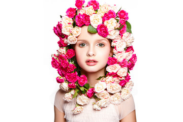 Beautiful baby girl portrait with flowers on head. Young and fresh face.