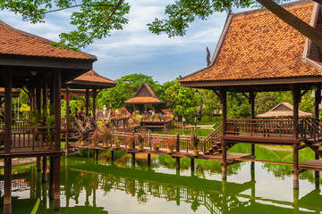 Lovely view of the floating village in the Cambodian Cultural Village in Siem Reap, Cambodia. Tourists enjoy walking on the wooden structures on stilts which are reflected by the water of the lake. Fototapete