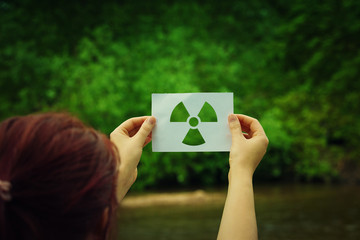 holding radiation symbol