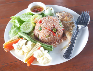 Fried rice with shrimp paste chili sauce top up with fried mackerel served with fresh and fried vegetable. Favourite delicious Thailand street food.