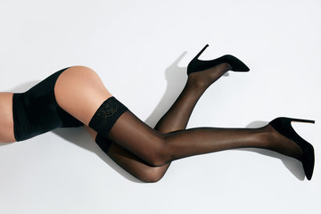 Woman Legs In Black Stockings