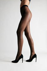 Black Tights. Female Legs Wearing Pantyhose