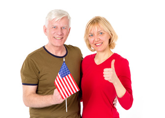 American family. Adult couple, man and woman, middle-aged with the flag of the USA on a white background.