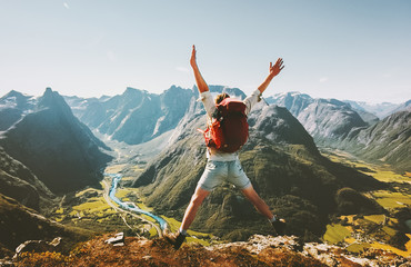 Happy Man traveler jumping with backpack Travel Lifestyle adventure concept active summer vacations outdoor in Norway mountains success and fun euphoria emotions Wall mural