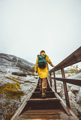 Woman climbing up stairs alone in mountains Traveling adventure healthy Lifestyle active vacations
