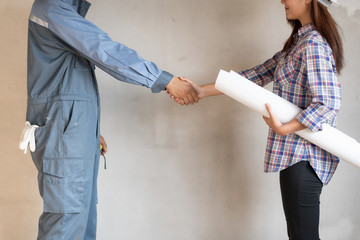 Tachnician man handshake with engineer woman. Success in engineering project.