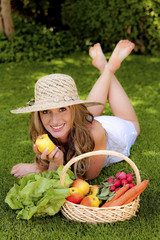 fruits and vegetables in the basket with woman