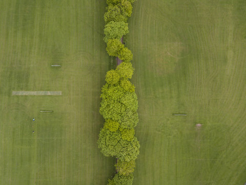 Houses and park drone aerial above view british residential