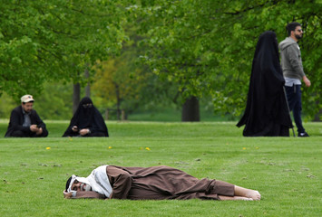 People relax in Hyde Park in London, Britain