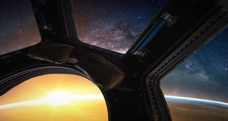 Landscape with Milky way galaxy. Sunrise, Earth and Spacecraft view from space with Milky way galaxy. (Elements of this image furnished by NASA)