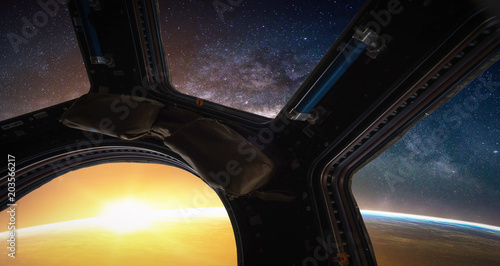 Wall mural Landscape with Milky way galaxy. Sunrise, Earth and Spacecraft view from space with Milky way galaxy. (Elements of this image furnished by NASA)