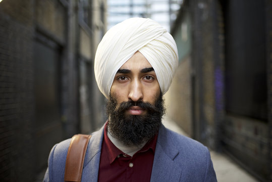 Portrait of a Sikh businessman in a city street