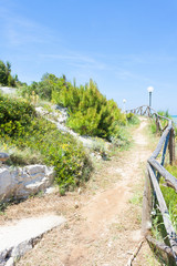 Lido Cala Lunga, Apulia - Hiking trail at the coastline of the Mediterranean Sea