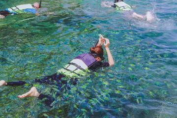 Happiness Tourists  snorkel at Similan Island Phang-Nga,Thailand