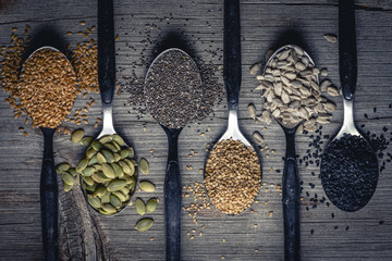 Spoons with assortment of seeds