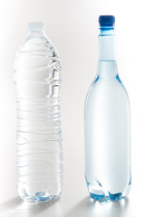 two purified water Group plastic bottles over white background