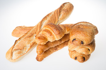 two baguettes croissants and breads chocolates concept of french bakery