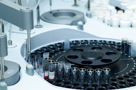 Medical laboratory centrifuge with test tubes with blood