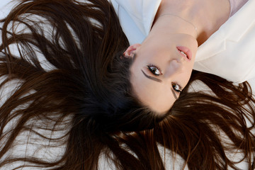 Beautiful long hair woman laying on floor