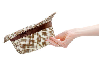 Hand holding summer hat. Isolated on white.