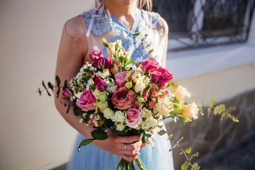 Wedding bouquet in girl's hands.