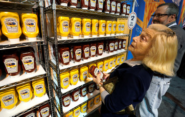 A shareholder look over commemorative Heinz ketchup and mustard at the Heinz exhibit at the Berkshire Hathaway Inc annual meeting, the largest in corporate America, in its hometown of Omaha