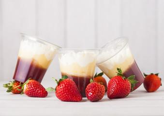 Plastic container with strawberry cream dessert