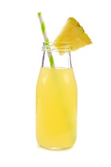 Pineapple juice in a milk bottle style glass with straw isolated on a white background