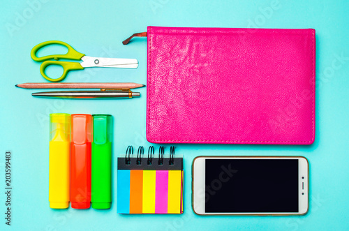 School Supplies On A Bright Blue Background, Top View, Concept Of  Education, Desktop
