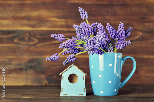 Mothers Day flowers in the mug and bird house decoration