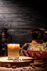 alcohol cocktail with coffee on wooden board on table