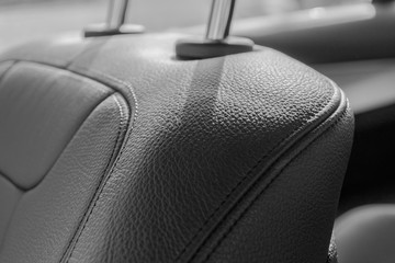 Modern Luxury sport car inside. Interior of prestige car. Black Leather seats with stitching. Black perforated leather. Modern car interior details.