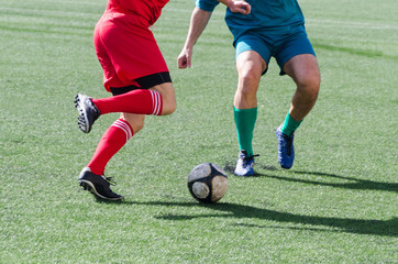 soccer players dribbling
