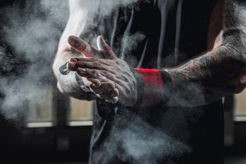 Close up of hands with chalk ready for exercising