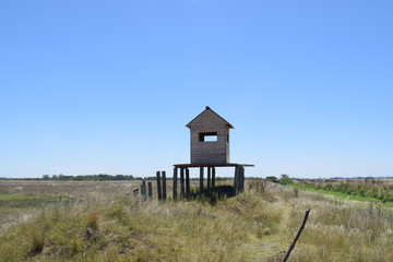 wooden keeper's house in the middle of the field