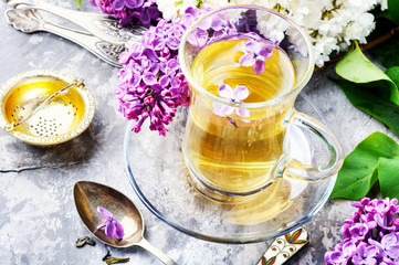 Wall Mural - Tea with lilac flavor